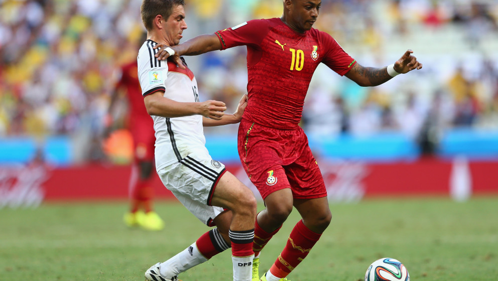 FORTALEZA, BRAZIL - JUNE 21:  Philipp Lahm of Germany challenges Andre Ayew of Ghana during the 2014 FIFA World Cup Brazil Gr