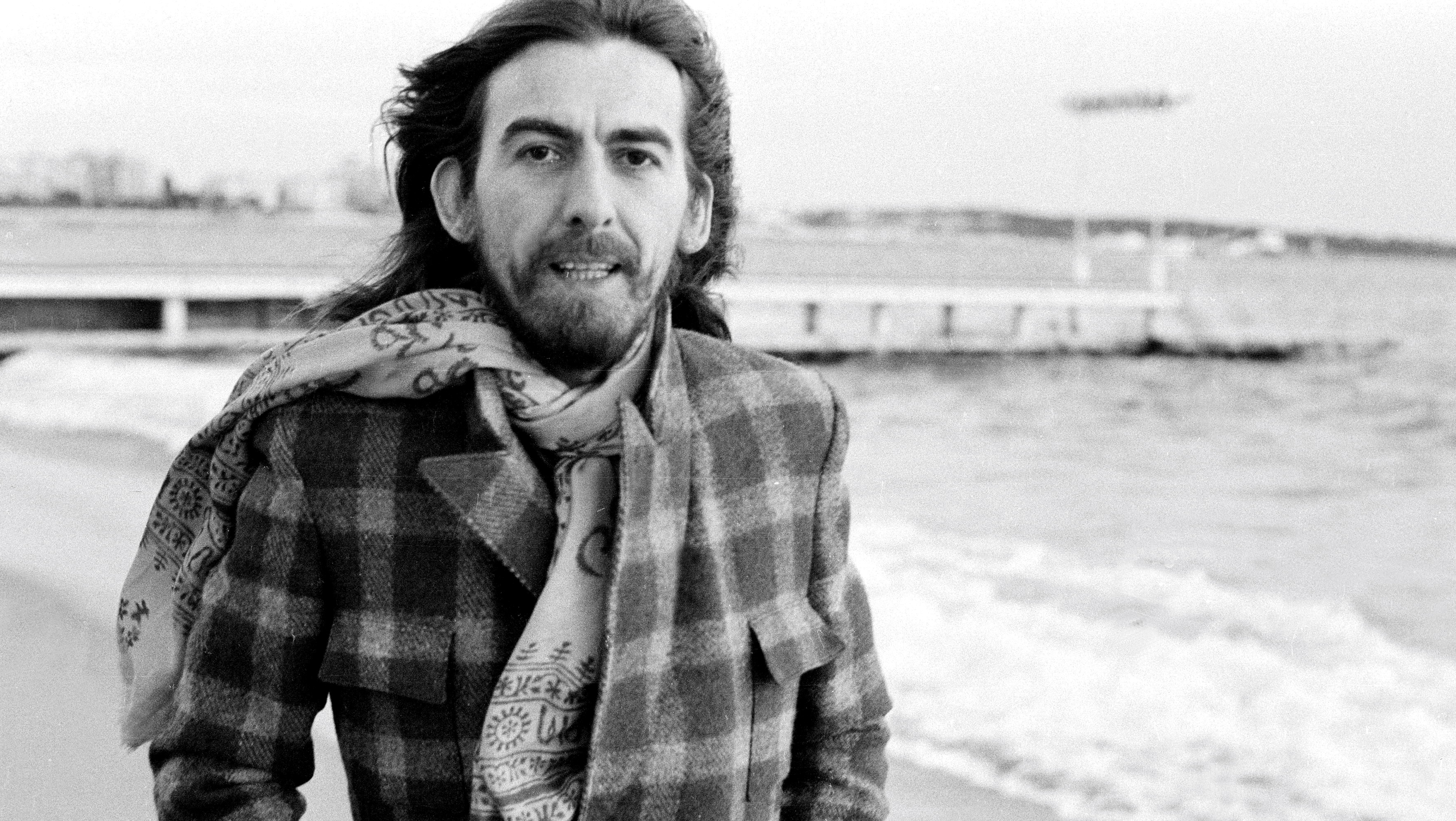 Former Beatle George Harrison (1943 - 2001) on the beach at Cannes, France in 1976. (Photo by Michael Putland/Getty Images)