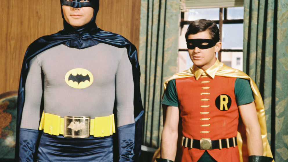 Adam West, US actor, and Burt Ward, US actor, both in costume as the 'Dynamic Duo' in a publicity still issued for the televi