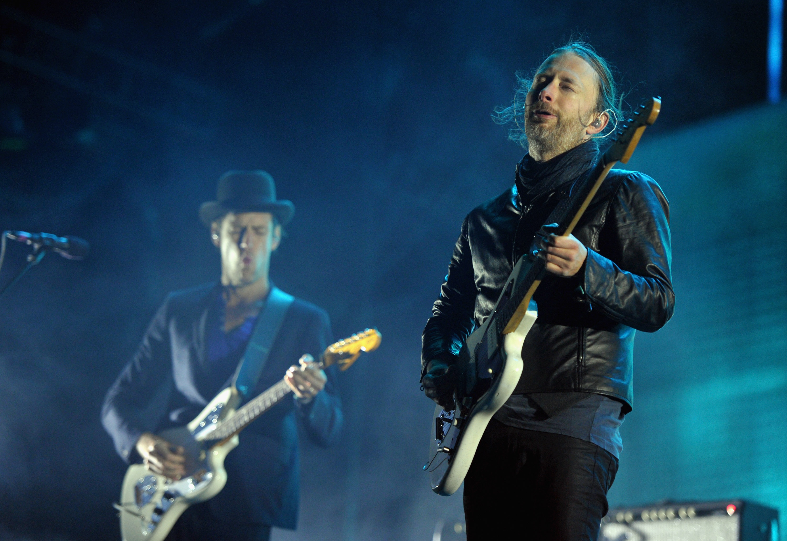 INDIO, CA - APRIL 14:  Musician Ed O'Brien and singer Thom Yorke of Radiohead perform during Day 2 of the 2012 Coachella Vall