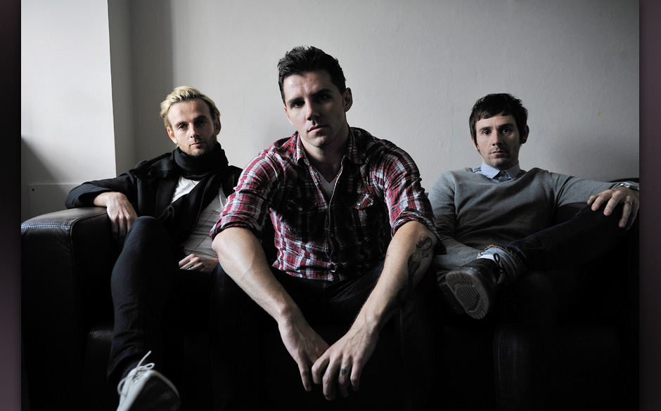 (L-R) Lee Gaze, Stuart Richardson and Mike Lewis of Welsh hard rock group Lostprophets being interviewed for Total Guitar on