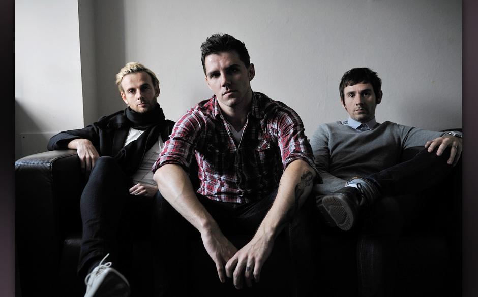 (L-R) Lee Gaze, Stuart Richardson and Mike Lewis of Welsh hard rock group Lostprophets being interviewed for Total Guitar on
