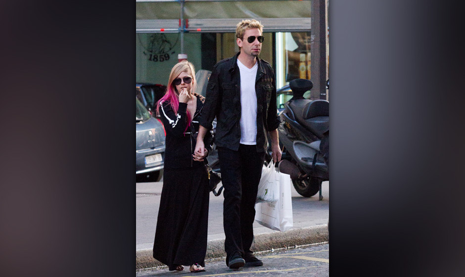 PARIS, FRANCE - SEPTEMBER 13:  Singer Avril Lavigne and Chad Kroeger are seen strolling on September 13, 2012 in Paris, Franc