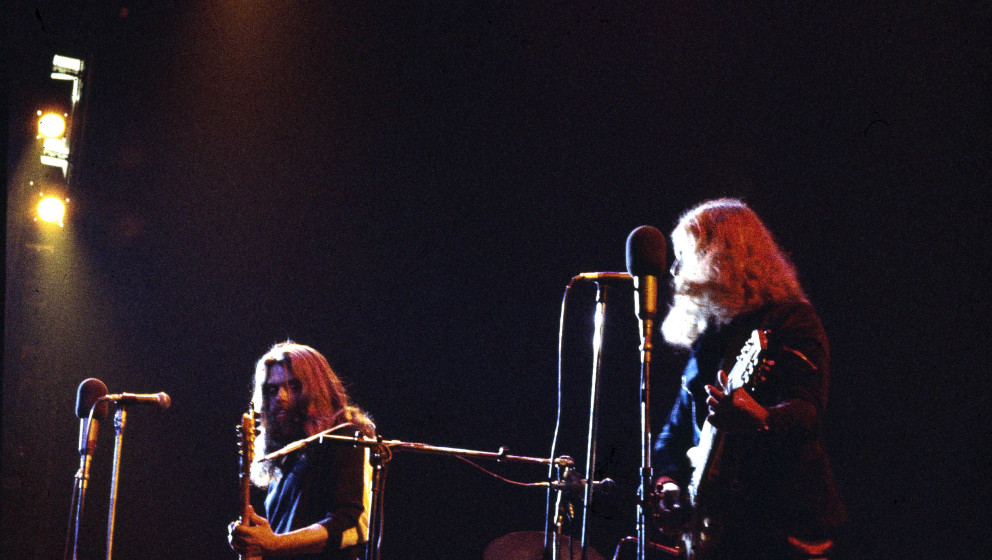 The Byrds perform on stage at the Rainbow Theatre, London 16th January 1972, L-R Clarence White, Skip Battin, Gene Parsons, R