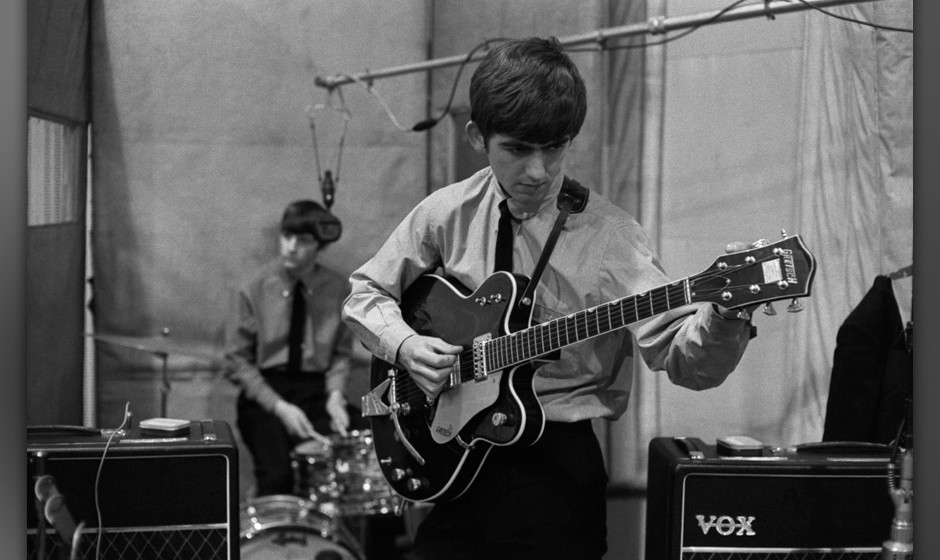Ringo Starr and George Harrison of The Beatles in Studio 2 at Abbey Road in London recording the single 'She Loves You', 1st
