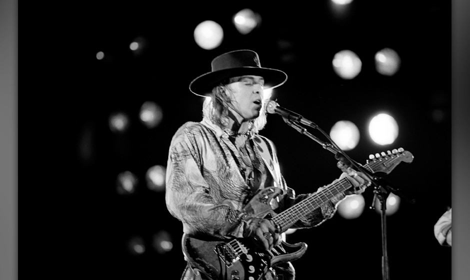 Stevie Ray Vaughan performing at the Pier in New York City on June 26, 1986. (Photo by Ebet Roberts/Redferns)