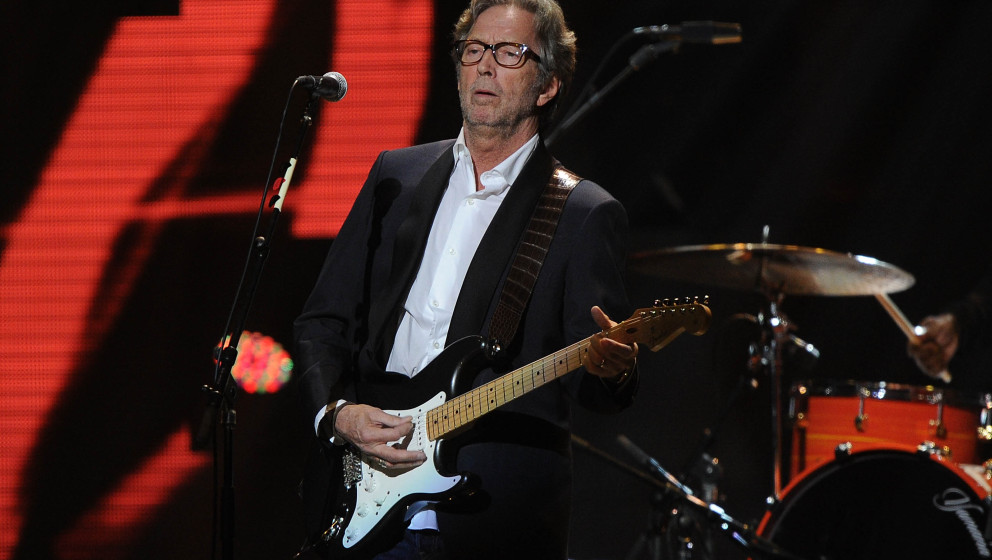 NEW YORK, NY - DECEMBER 12:  Eric Clapton performs at '12-12-12' a concert benefiting The Robin Hood Relief Fund to aid the v