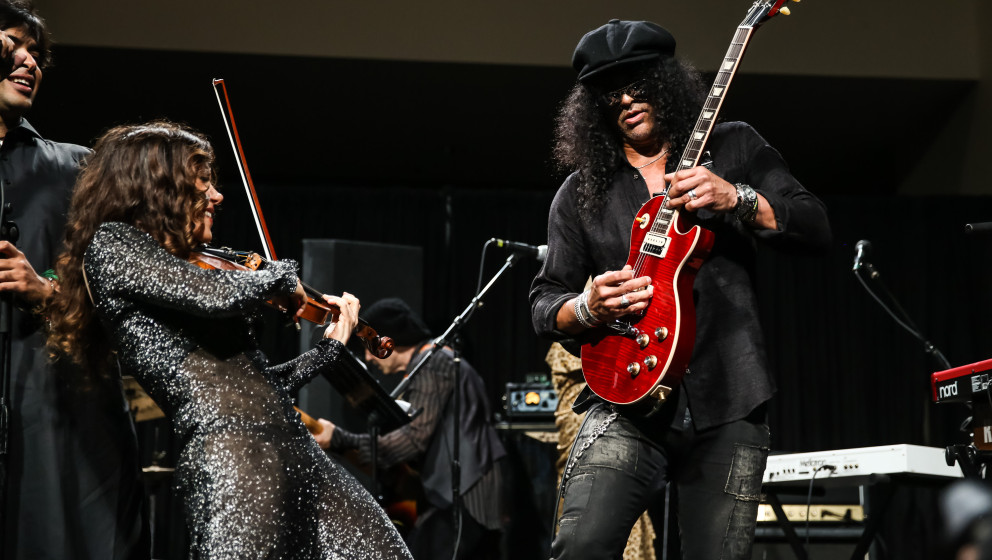 HOLLYWOOD, CA - SEPTEMBER 15:  Violinist Lili Haydn (L) and guitarist Slash perform at Adopt the Arts' Peace Through Music ce