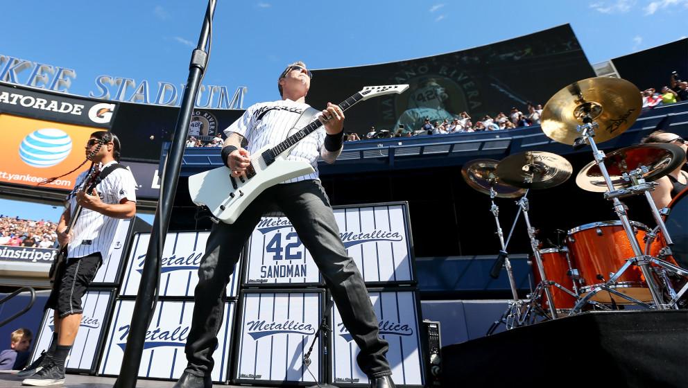 NEW YORK, NY - SEPTEMBER 22:   James Hetfield and Robert Trujillo (L) of Metallica perform Enter Sandman to honor pitcher Mar