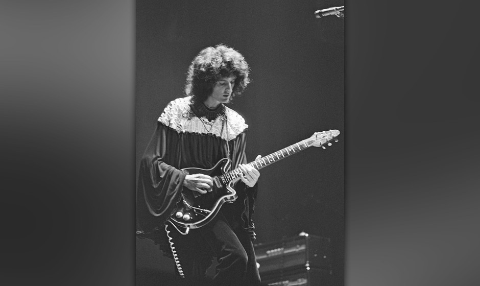 Guitarist Brian May performing with British rock group Queen, UK, November 1973. (Photo by Michael Putland/Getty Images)