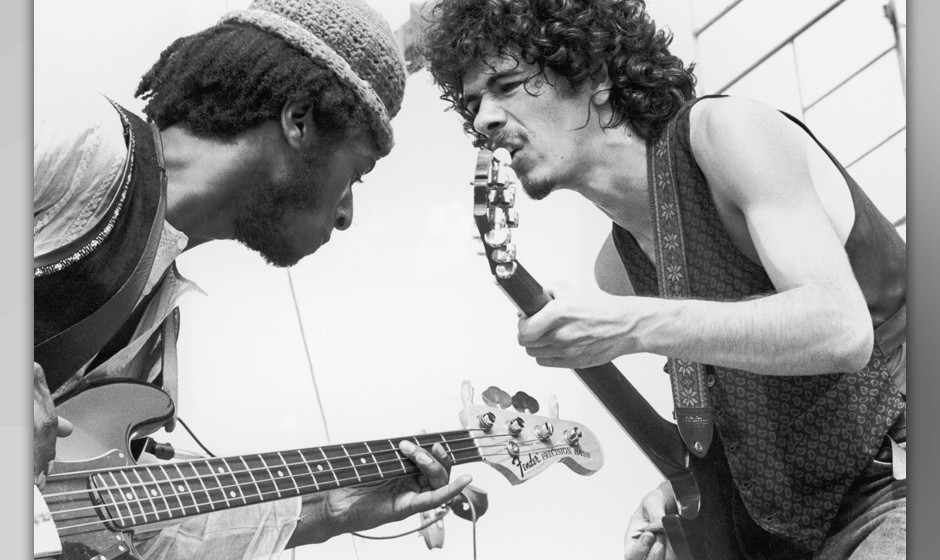 August 1969:  Mexican-born guitarist Carlos Santana (right) and bassist David Brown perform with the group Santana at the Woo
