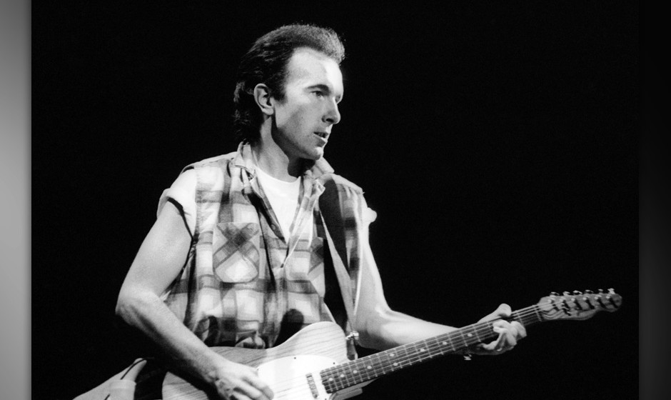 SYDNEY, AUSTRALIA - 1984: Guitarist The Edge with the band 'U2' performing live on stage at the Sydney Entertainment Centre d