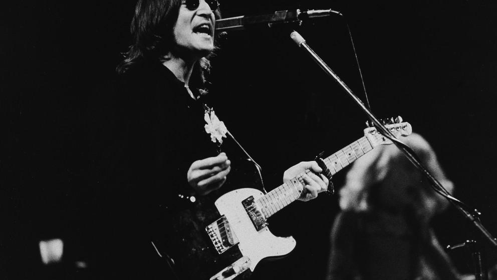 British musician John Lennon (1940 - 1980) performs onstage in Madison Square Garden, New York, New York, November 28, 1974.