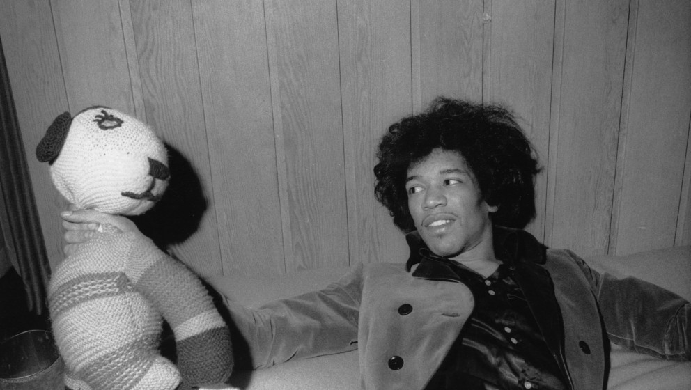 UNITED KINGDOM - JANUARY 01:  Photo of Jimi HENDRIX; posed, at home in 34 Montagu Square, London, on bed, with soft toy  (Pho