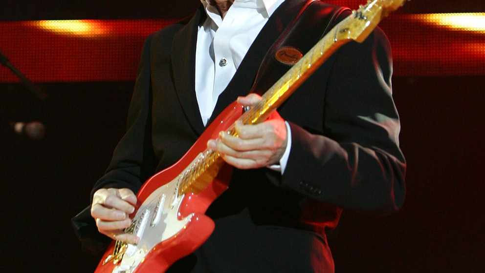 LONDON, ENGLAND - SEPTEMBER 28: Hank Marvin of  The Shadows performs live on stage at the O2 Arena on September 28, 2009 in L