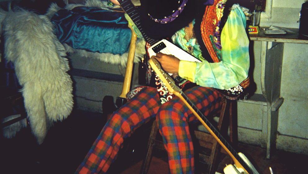 UNITED KINGDOM - JANUARY 01:  Photo of Jimi HENDRIX; playing Gibson Flying V guitar in flat  (Photo by Odile Noel?/Redferns)