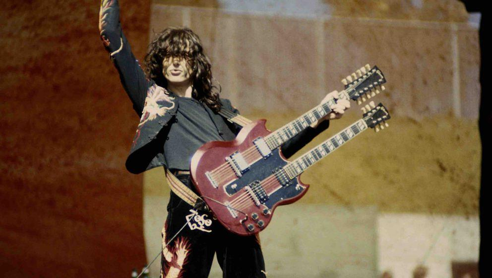 OAKLAND, CA -  JULY 23:  Jimmy Page performing with 'Led Zeppelin at the Oakland Coliseum in Oakland, California on July 23,