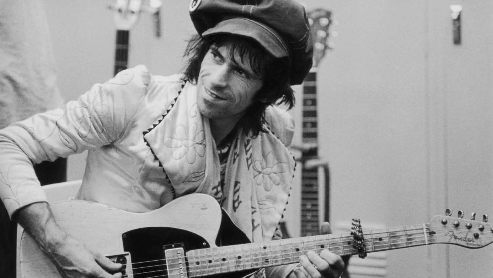 Guitarist Keith Richards strums backstage during the Rolling Stones Tour of the Americas, 1975. (Photo by Christopher Simon S