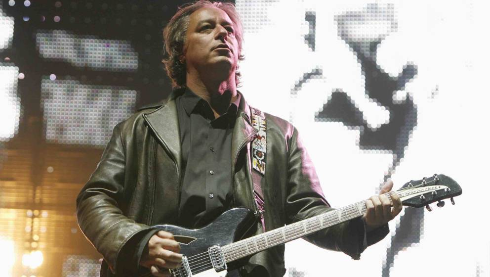 UNITED KINGDOM - AUGUST 30:  TWICKENHAM  Photo of Peter BUCK and REM, Peter Buck performing on stage  (Photo by Stuart Mostyn