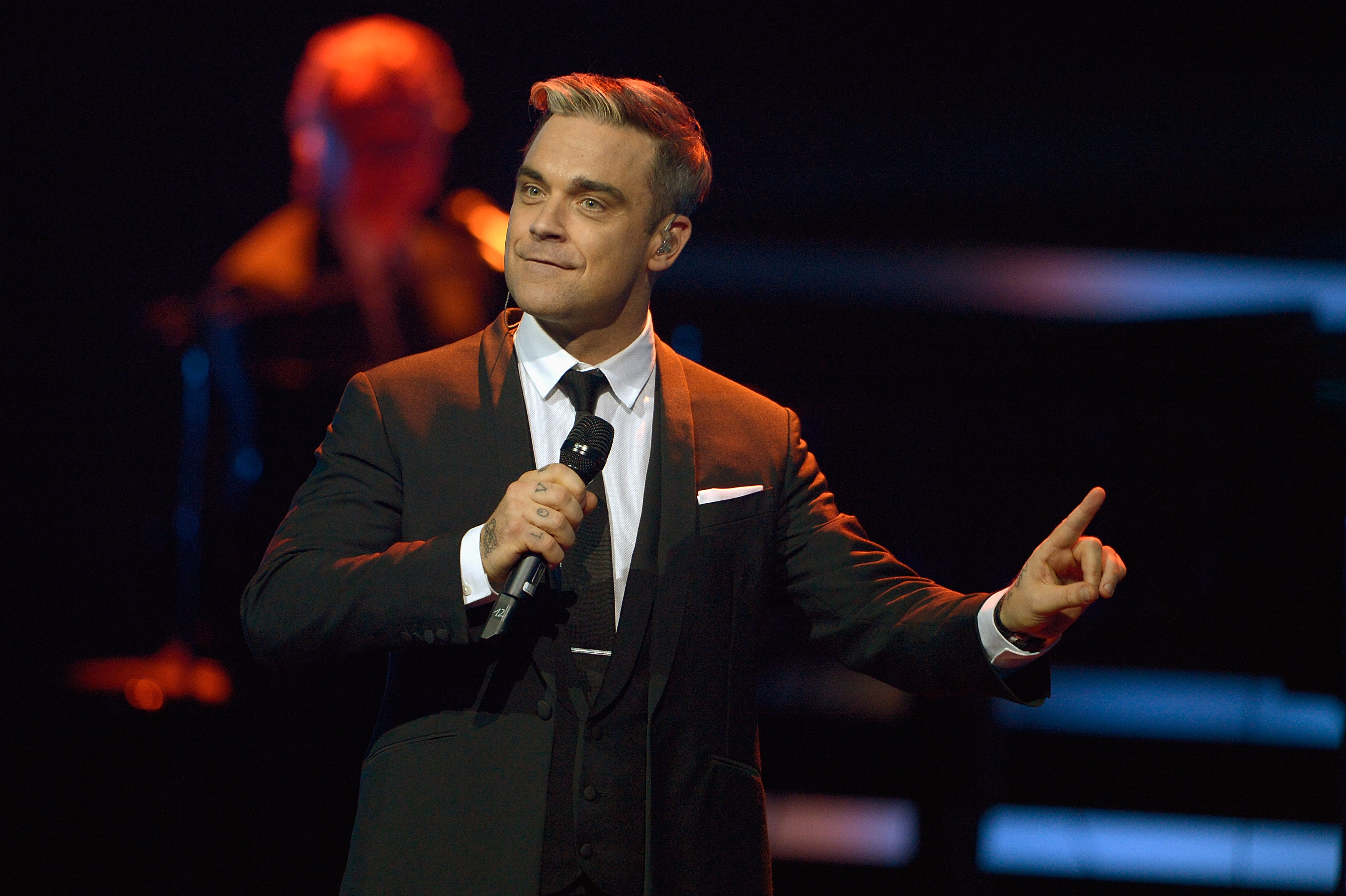 BERLIN, GERMANY - NOVEMBER 14:  Robbie Williams performs on stage at the Bambi Awards 2013 at Stage Theater on November 14, 2