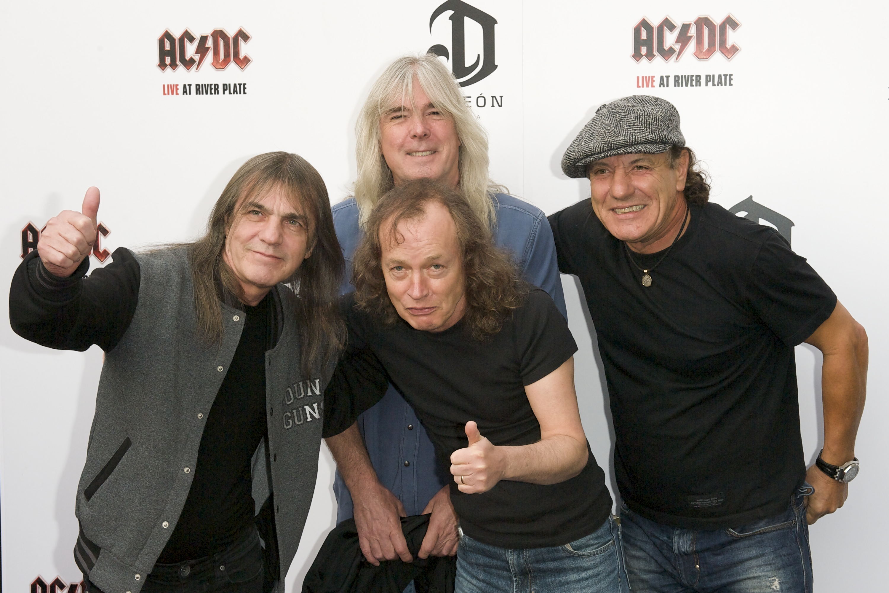 LONDON, ENGLAND - MAY 06:  (L-R) AC/DC band members Malcolm Young, Cliff Williams, Angus Young and Brian Johnson attend the E