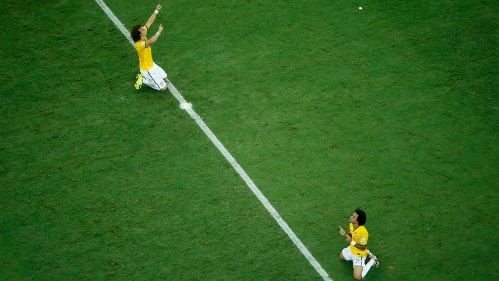 FORTALEZA, BRAZIL - JULY 04:  David Luiz (L) and Marcelo of Brazil celebrate defeating Colombia 2-1 in  the 2014 FIFA World C