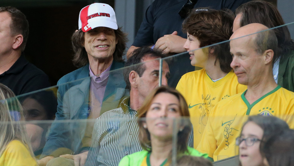BELO HORIZONTE, BRAZIL - JULY 8:  Mick Jagger and his son Lucas attend the 2014 FIFA World Cup Brazil Semi Final match betwee