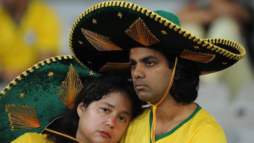 BELO HORIZONTE, BRAZIL - JULY 08: Brazil fans look dejected following the 2014 FIFA World Cup Brazil Semi Final match between