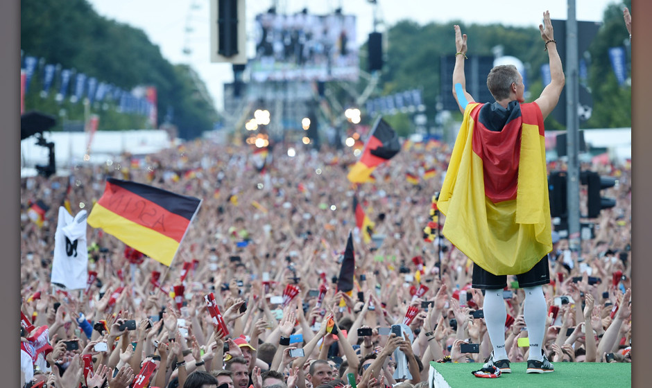 BERLIN, GERMANY - JULY 15: Bastian Schweinsteiger celebrates on stage at the German team victory ceremony on July 15, 2014 in