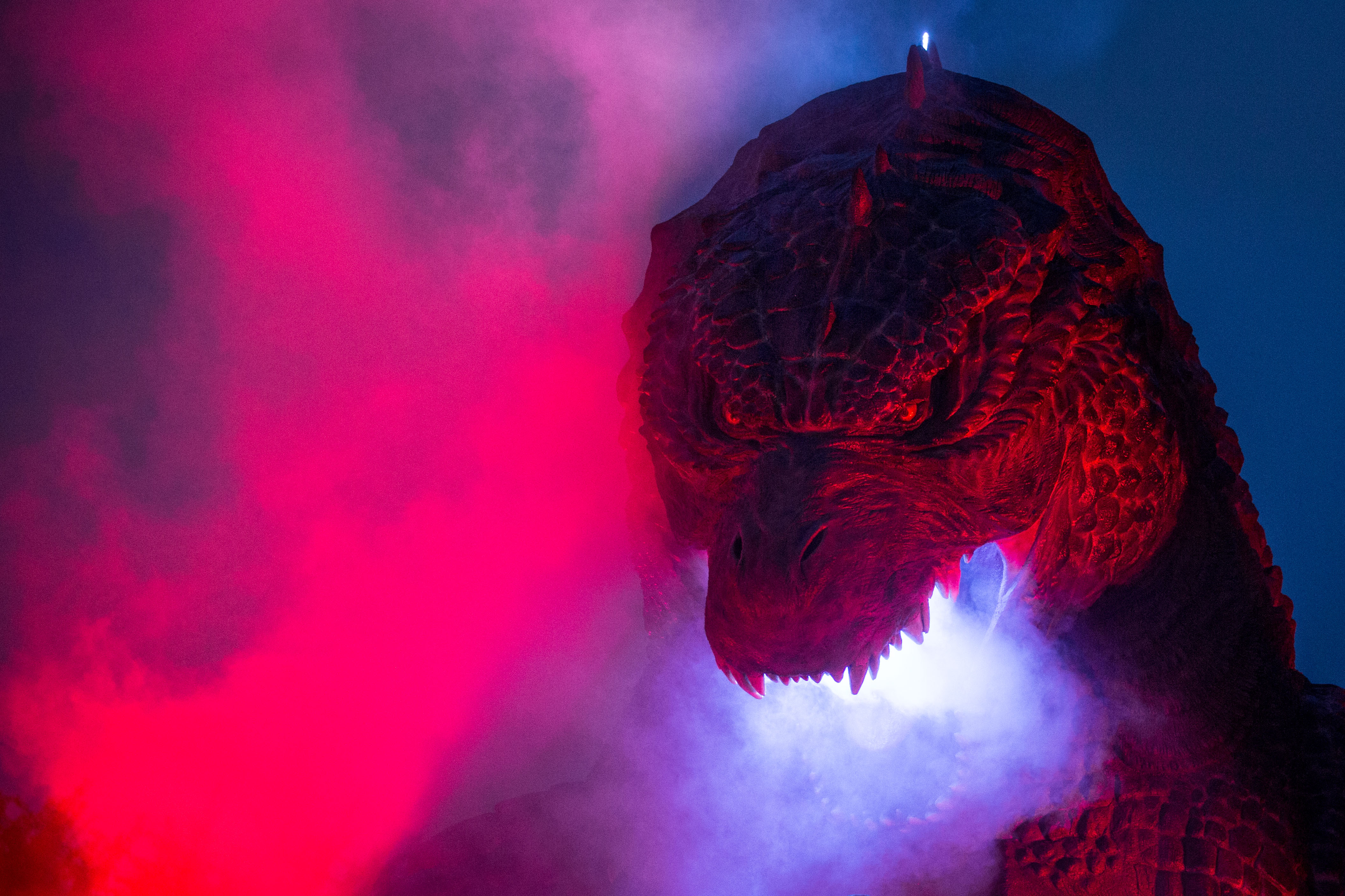 TOKYO, JAPAN - JULY 17:  (EDITORIAL USE ONLY) A 6.6 meter replica Godzilla is lit up during a press preview at Tokyo Midtown