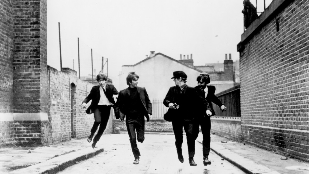 LONDON - AUGUST 11:  Rock and roll band 'The Beatles'  in a still from their movie 'A Hard Day's Night' which was released on