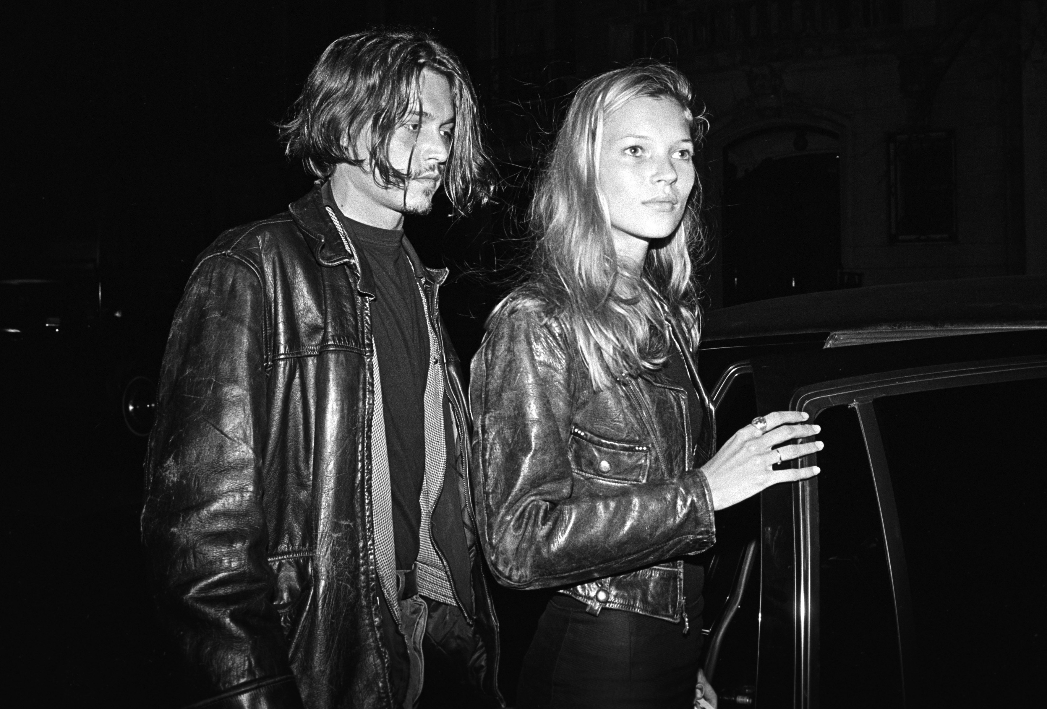 NEW YORK - 1994:  British supermodel Kate Moss (R) and American actor Johnny Depp leaving  a party for John Waters' film 'Ser