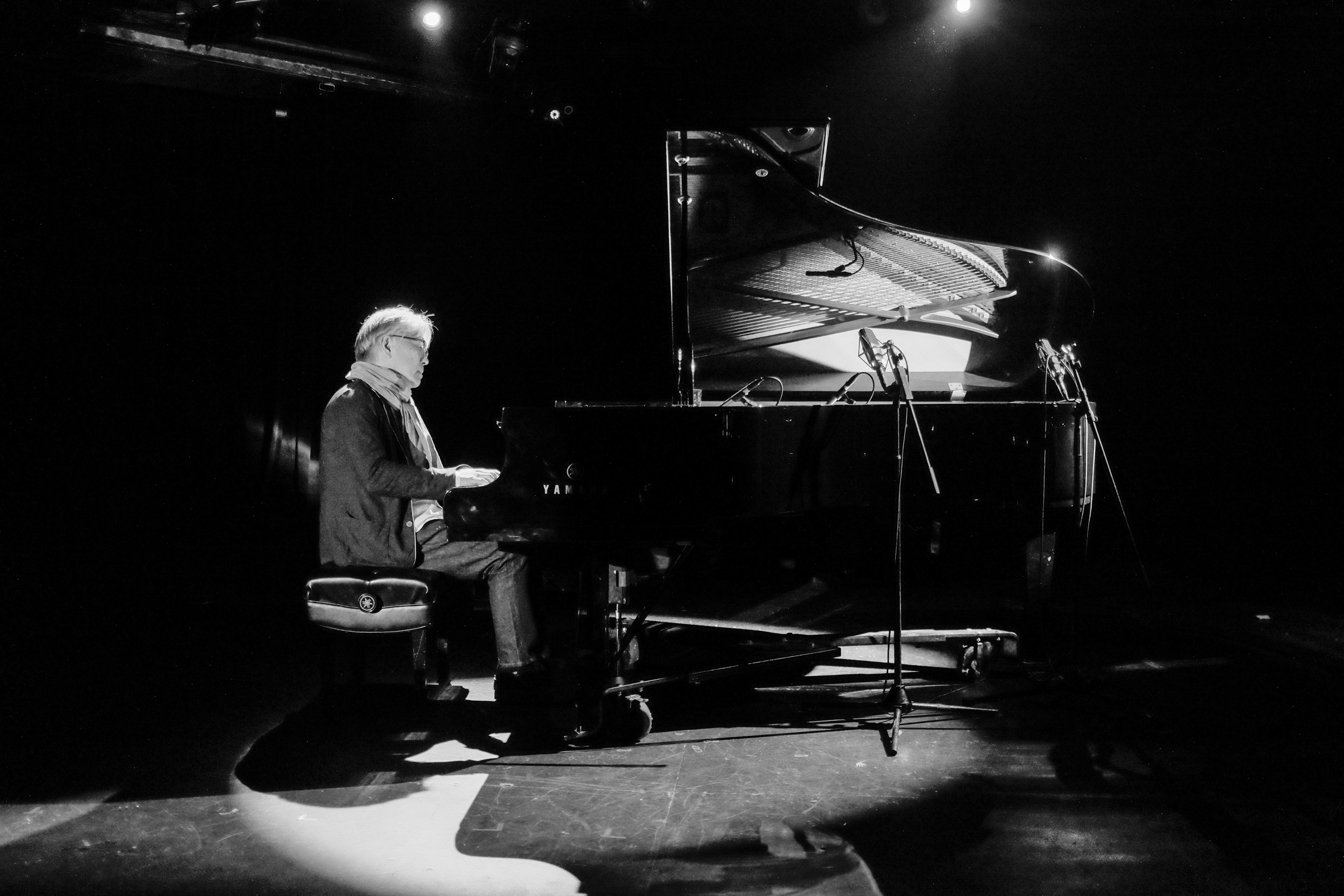 NEW YORK, NY - MAY 10: Japanese composer Ryuichi Sakamoto plays music he wrote for Linda Hoaglund's new documentary film 'The