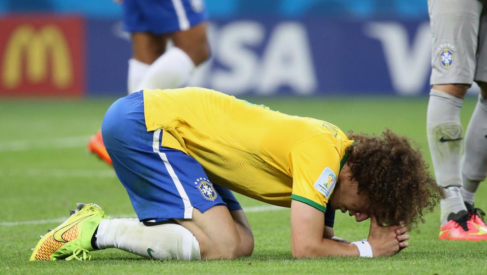 BELO HORIZONTE, BRAZIL - JULY 8: David Luiz of Brazil looks dejected after the 2014 FIFA World Cup Brazil Semi Final match be