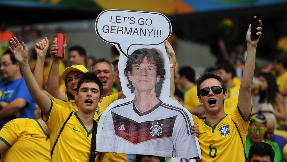 BELO HORIZONTE, BRAZIL - JULY 08: Brazil fans hold up a poster of Mick Jagger during the 2014 FIFA World Cup Brazil Semi Fina