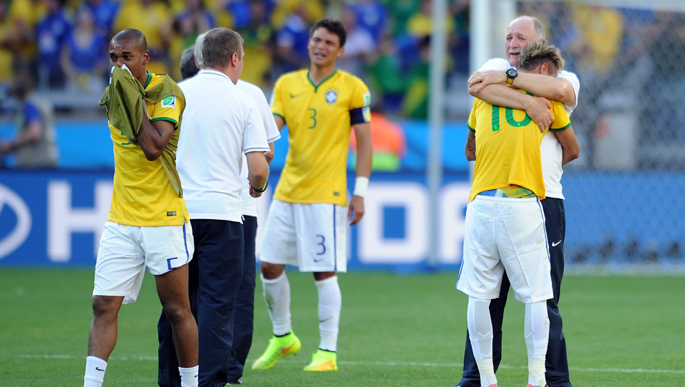 BELO HORIZONTE, BRAZIL - JUNE 28: Neymar of Brazil is embraced by manager Luis Felipe Scolari following the 2014 FIFA World C