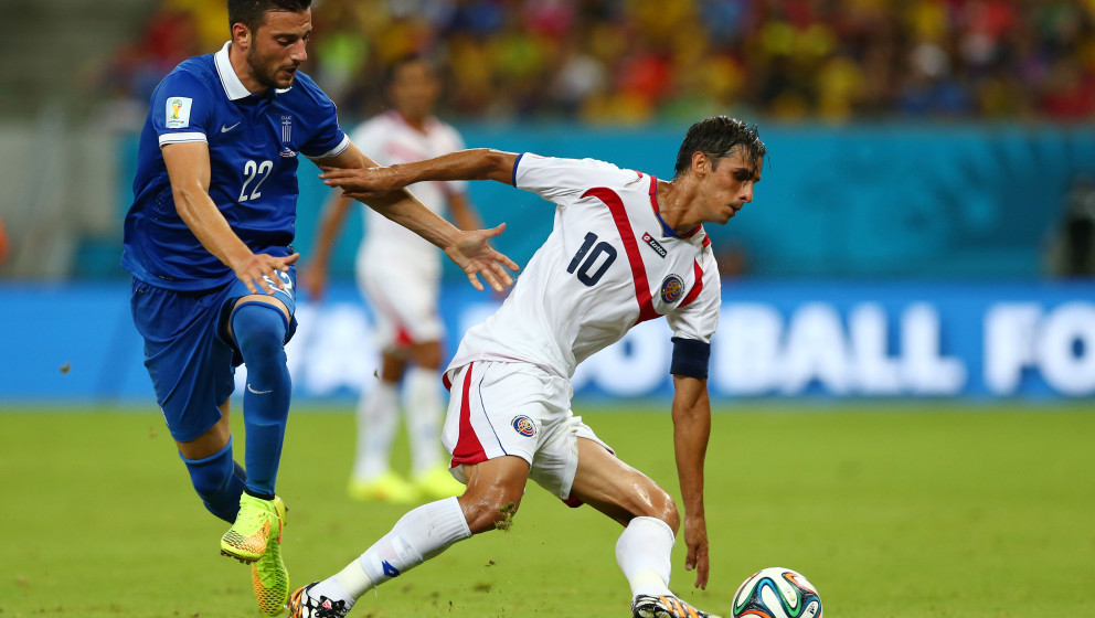 RECIFE, BRAZIL - JUNE 29:  Andreas Samaris of Greece challenges Bryan Ruiz of Costa Rica during the 2014 FIFA World Cup Brazi
