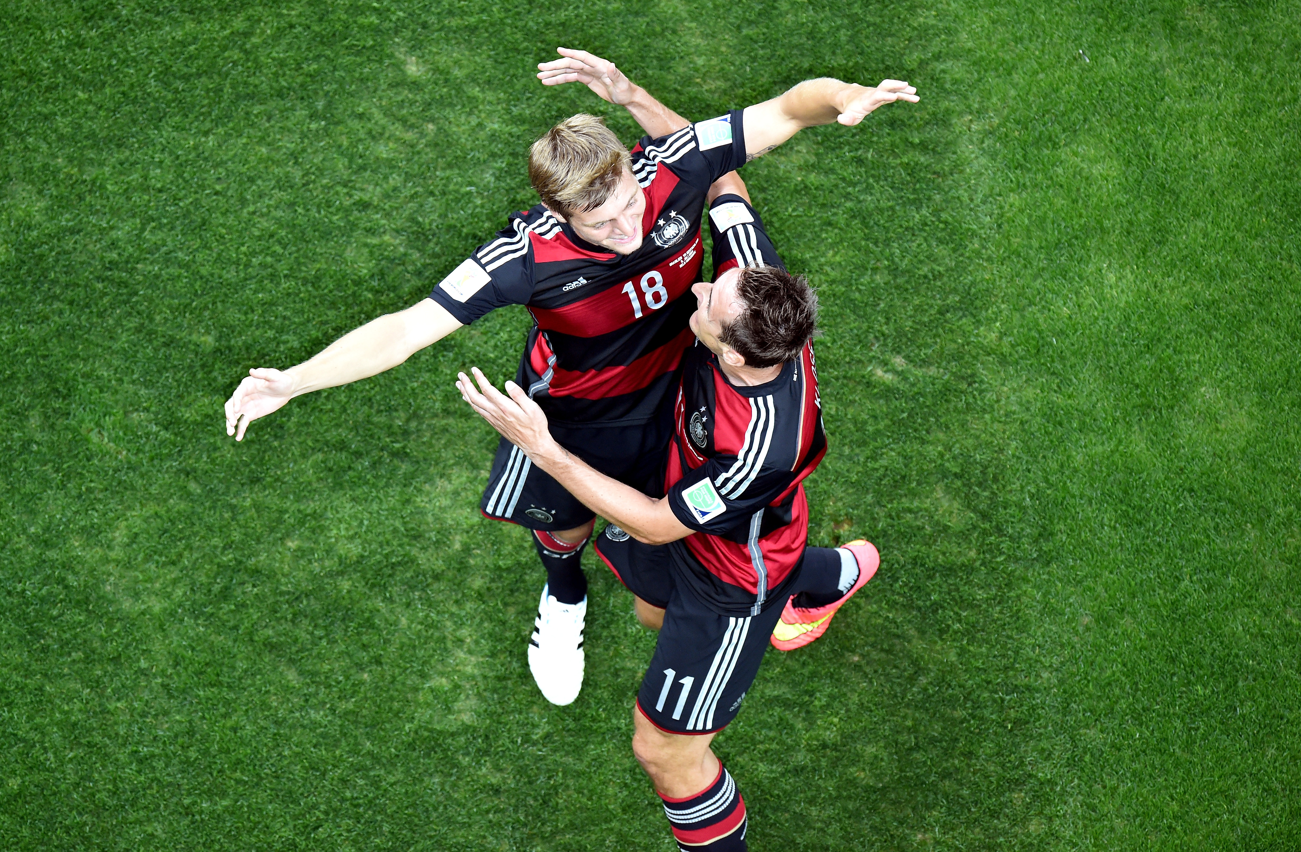 BELO HORIZONTE, BRAZIL - JULY 08: Toni Kroos of Germany (L) celebrates scoring his team's third goal with teammate Miroslav K