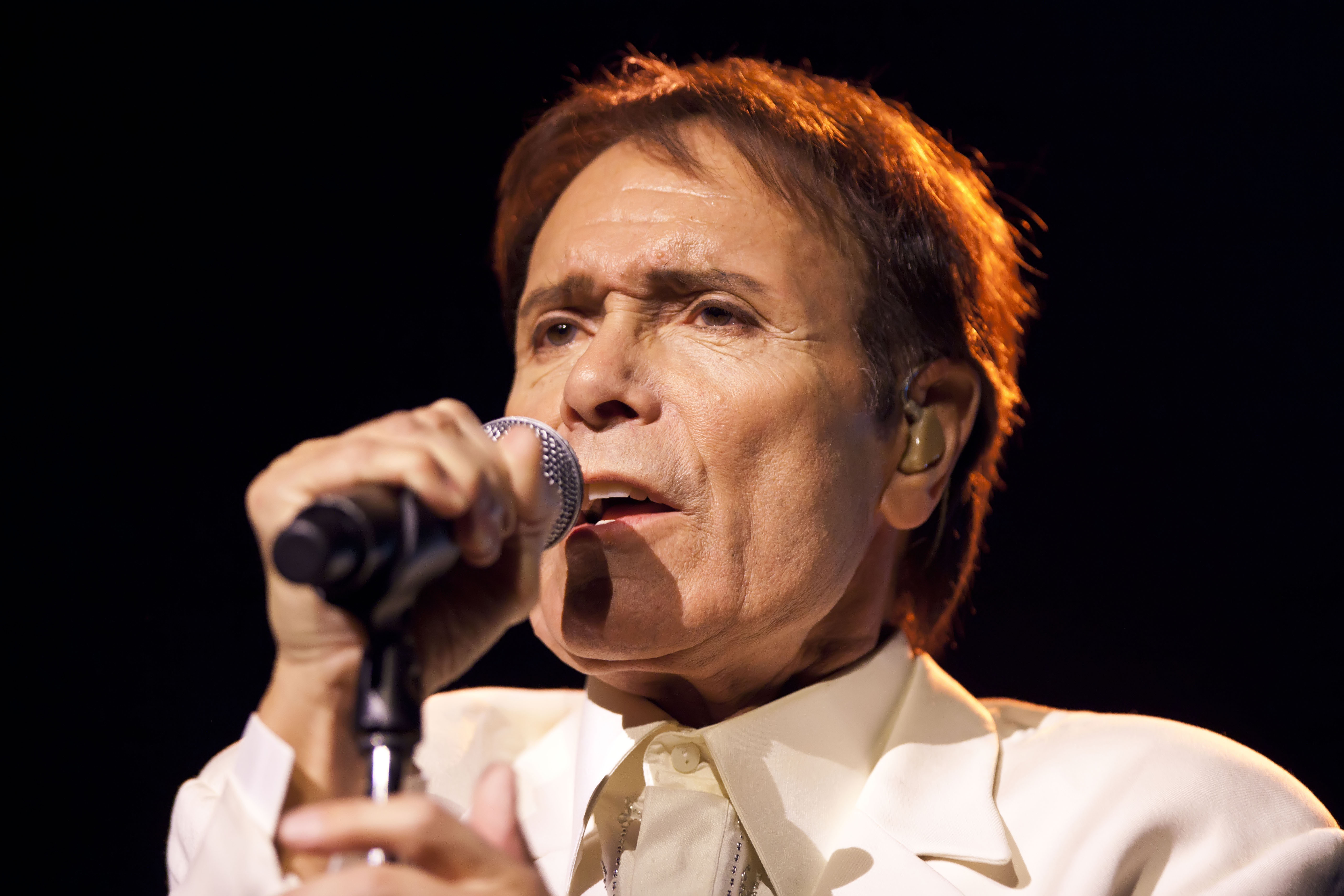 BERLIN, GERMANY - DECEMBER 03:  British pop singer Sir Cliff Richard peforms live during the Nokia Night Of The Proms concert