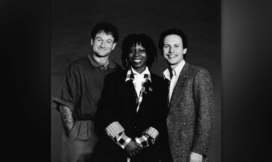 Promotional studio portrait of American comedians and Robin Williams, Whoopi Goldberg and Billy Crystal, the hosts of the 'Co