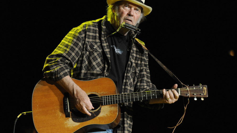 MOUNTAIN VIEW, CA - OCTOBER 23: Neil Young performs as part of the 25th Annual Bridge School Benefit at Shoreline Amphitheatr