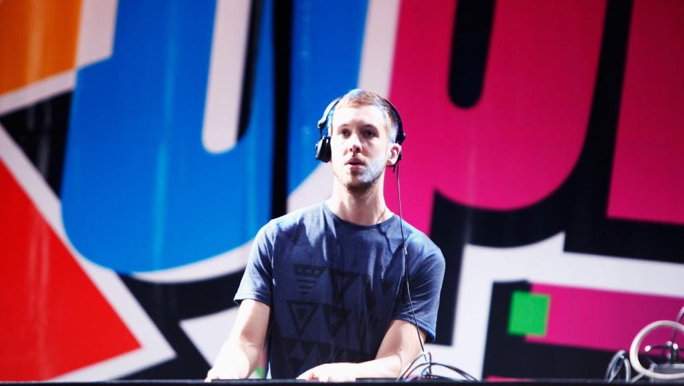 HOLMDEL, NJ - MAY 20:  DJ Calvin Harris spins onstage at 103.5 KTU's KTUphoria at PNC Bank Arts Center on May 20, 2012 in Hol