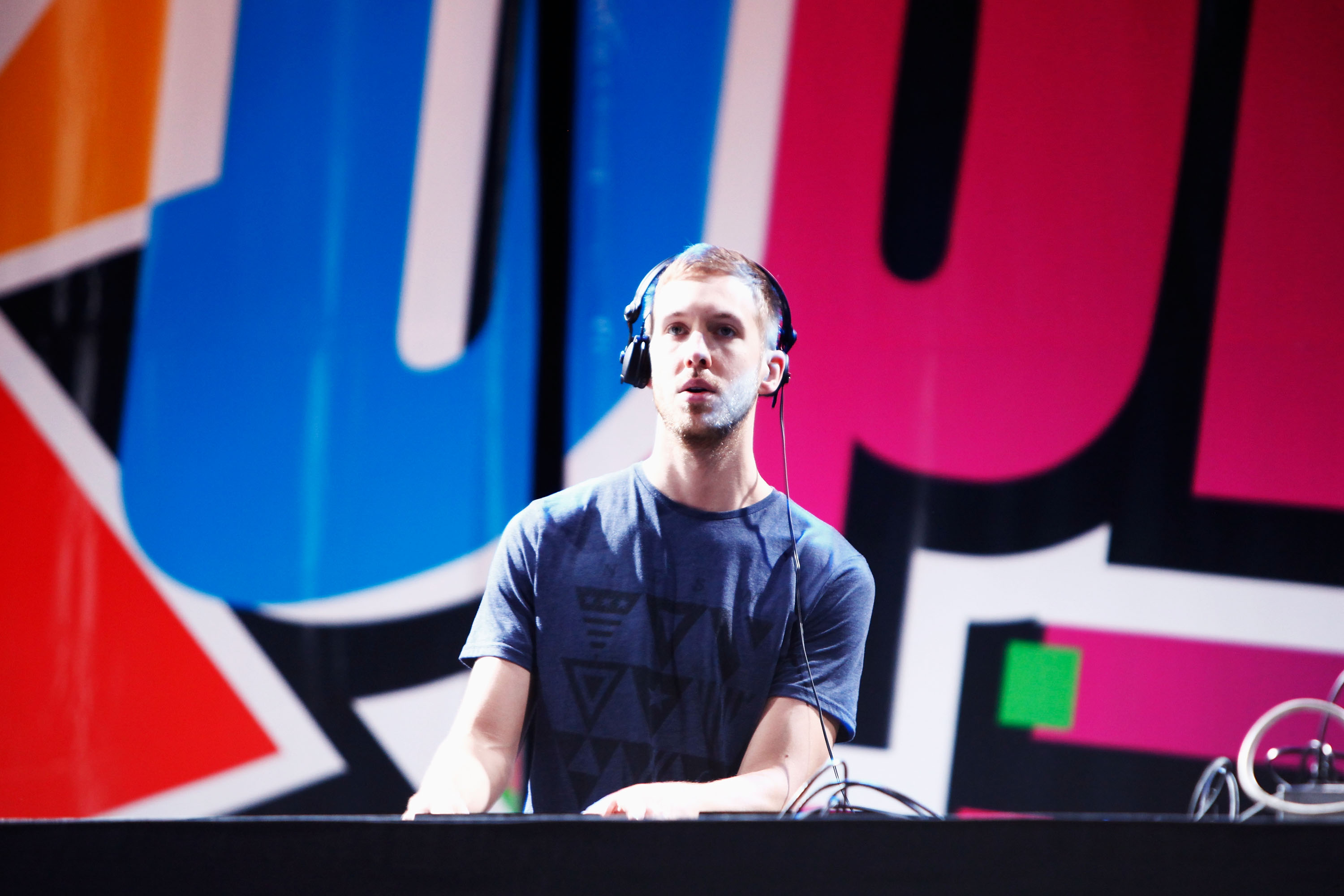 HOLMDEL, NJ - MAY 20:  DJ Calvin Harris spins onstage at 103.5 KTU's KTUphoria at PNC Bank Arts Center on May 20, 2012 in Hol