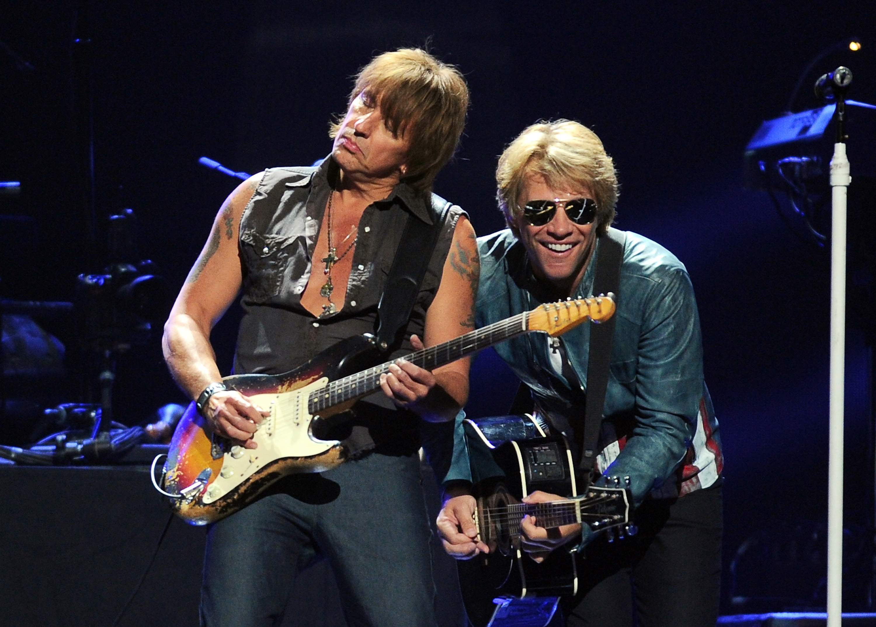 LAS VEGAS, NV - SEPTEMBER 21:  Guitarist Richie Sambora (L) and singer Jon Bon Jovi of Bon Jovi perform onstage during the 20
