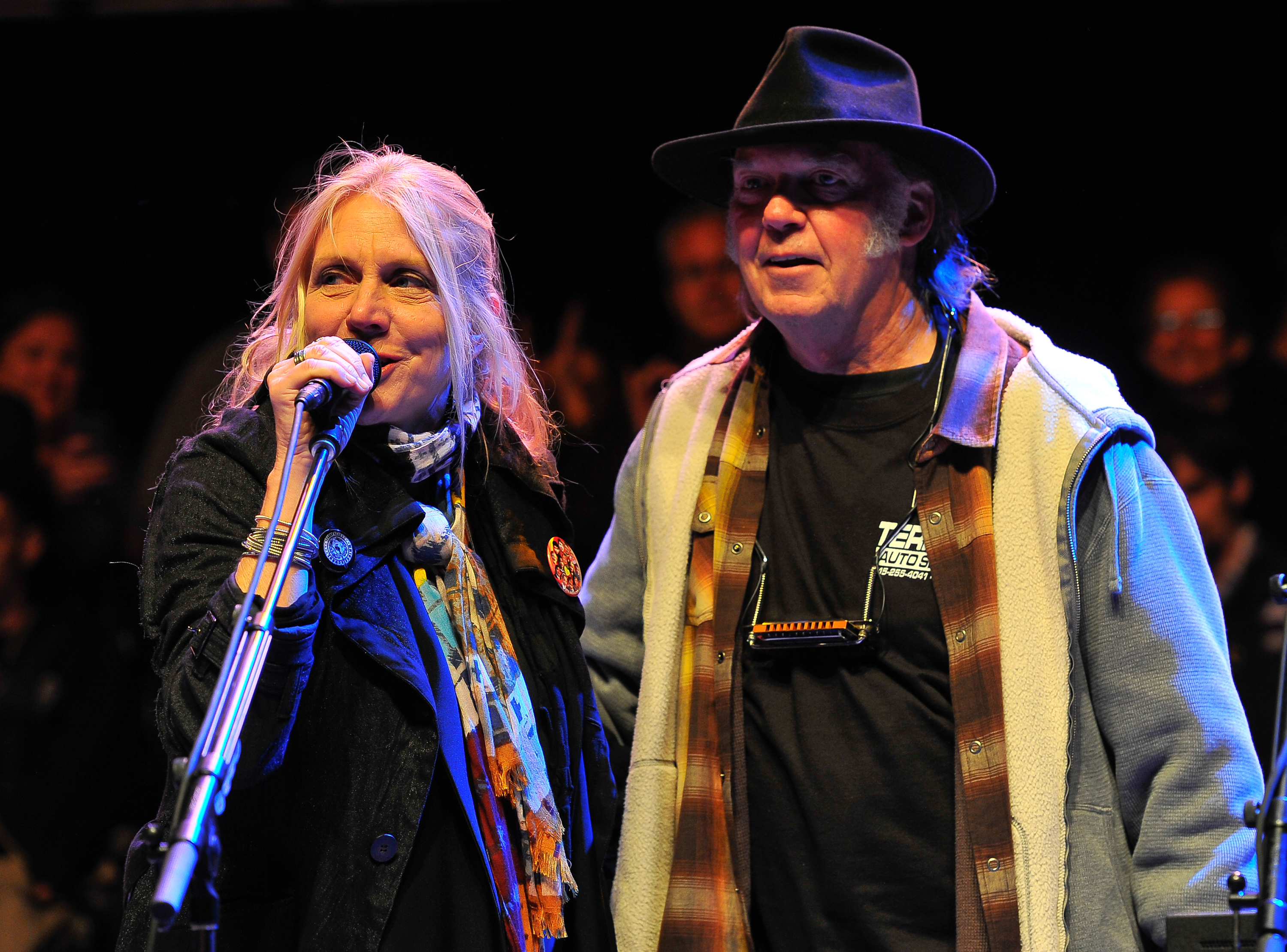 MOUNTAIN VIEW, CA - OCTOBER 27: Pegi Young and Neil Young (L-R) perform on Day 2 of the 27th Annual Bridge School Benefit con