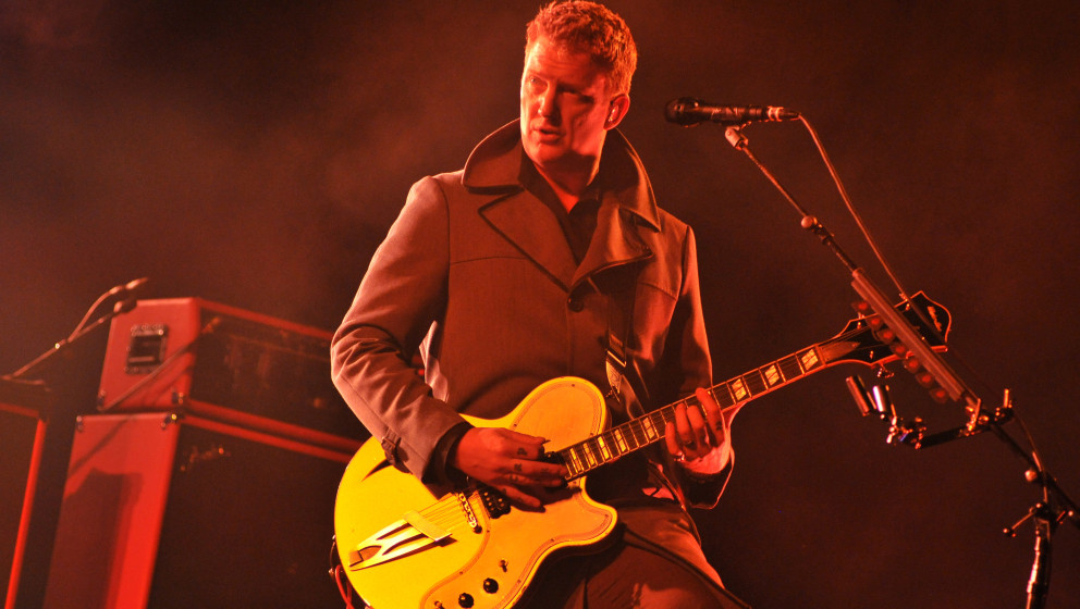 READING, UNITED KINGDOM - AUGUST 22: Josh Homme of Queens of the Stone Age performs on stage at the Reading Festival at Richf