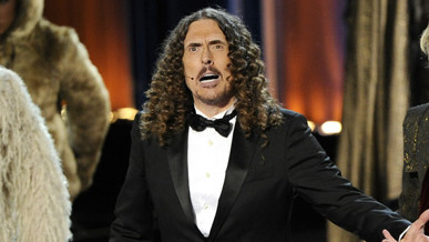 Weird Al Yankovic, left, and Andy Samberg perform on stage at the 66th Annual Primetime Emmy Awards at the Nokia Theatre L.A.