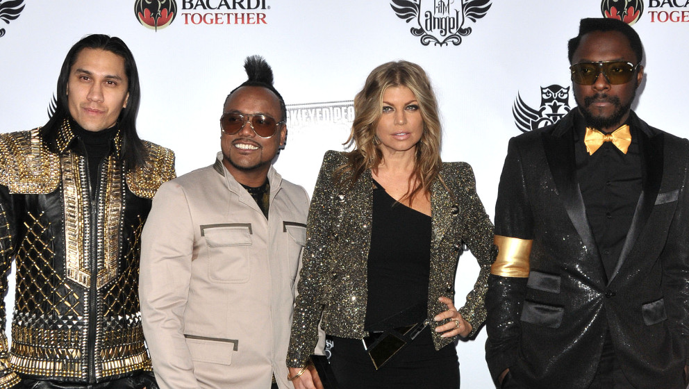 (L-R) Taboo, apl.de.ap, Fergie and Will.i.am of The Black Eyed Peas attend the 7th annual Peapod benefit concert at The Henry