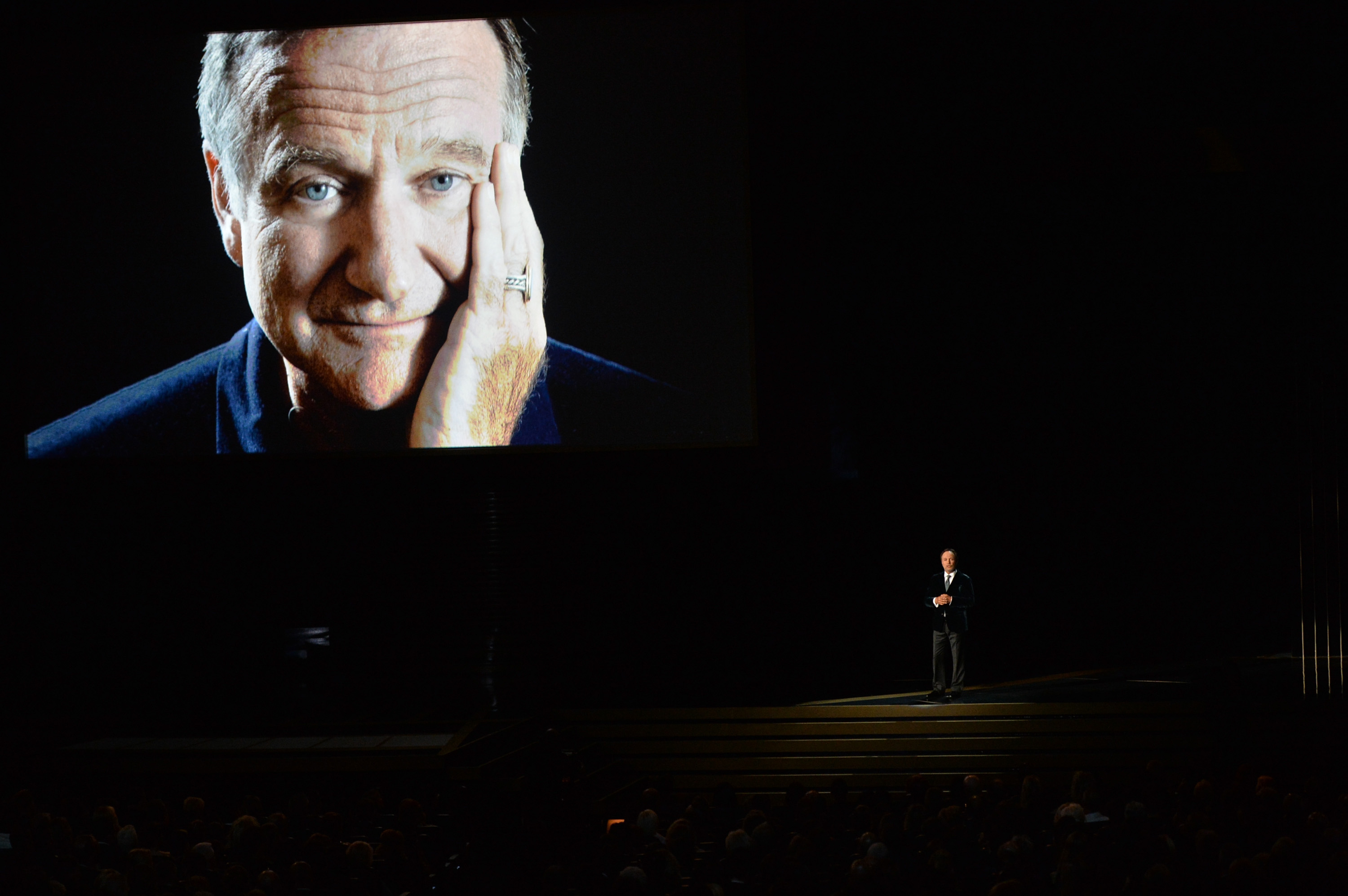 LOS ANGELES, CA - AUGUST 25:  Actor Billy Crystal (R) speaks in tribute to the late Robin Williams onstage at the 66th Annual