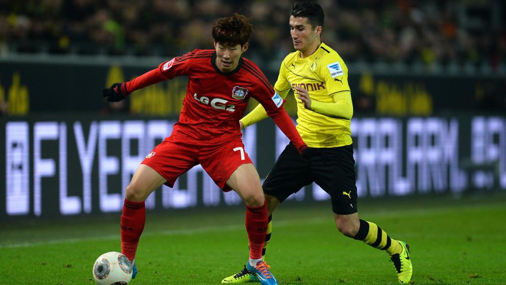 DORTMUND, GERMANY - DECEMBER 07:  Heung Min Son of Leverkusen is challenged by Nuri Sahin of Dortmund during the Bundesliga m